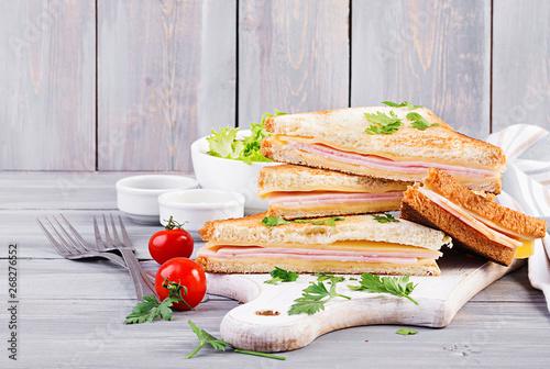 Club sandwich panini with ham, cheese and salad. Tasty breakfast