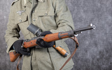 WW II German Soldier With Rifle And Grenade