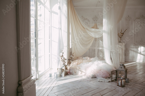 Fényképezés a large clean bright room with a window of white wooden floor, a mattress-bed, d