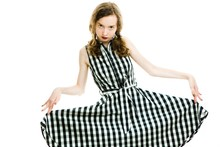 Teen Girl In Black Checkered Dress And Dark Make Up Posing.