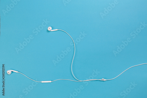 Foto op Aluminium Vissen white headphones on blue background