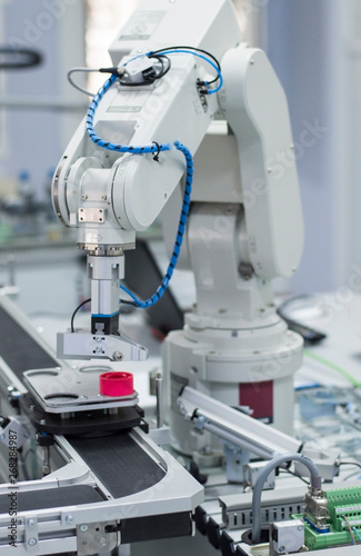 Photo Focus on robot arm's gripper