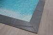 Leinwandbild Motiv grey brown corner swimming pool detail with stairs and blue water