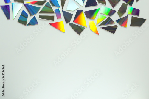Fotografía  Shiny iridescent splinters on white background