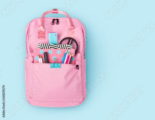 Obraz Children backpack with various school stationery isolated on blue background - fototapety do salonu