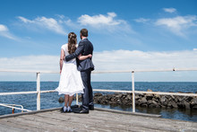 Bride And Groom Looking Out To Sea In Williamstown, Melbourne, Australia