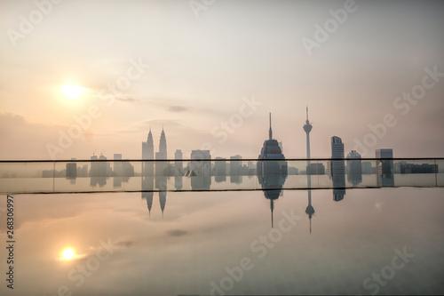 Kuala Lumpur, Malaysia, View of Kuala Lumpur City from roof top swimming pool at sunrise