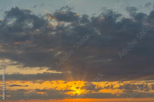 Fototapeta Clouds lit by the setting sun. obraz na płótnie