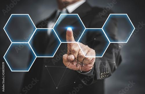 Poster Macarons businessman touching virtual screen on hexagon