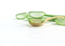 Group Of Aloe Vera On Spoon Herbal Medicine For Skin And Hair On Wooden Background