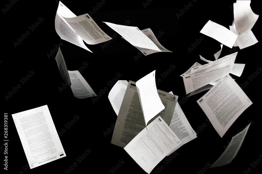 Fototapety, obrazy: Many flying business documents isolated on black background