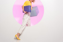 Cropped View Of Stylish Young Woman Holding Gift Boxes On White With Pink Circle And Copy Space