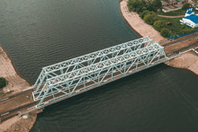 Steel Railroad Bridge With Rails Over River, Aerial Drone View,