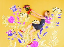 Top View Of Young Happy Elegant Woman With Bouquet Of Roses Lying On Yellow Background With Floral Illustration