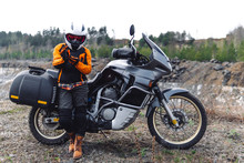 Biker Girl Wearing A Motorcycle Outfit, Protective Clothing, Equipment, Adventure Touristic Motorbike With Side Bags. Outdoor Travel, Active Traveler, Enduro, Off Road