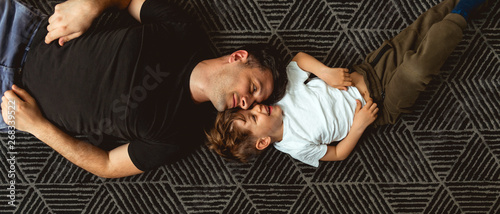 Fotografie, Obraz Father and Son Cuddle on the floor