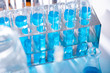 Test tube of glass overflows new liquid solution potassium blue conducts an analysis reaction takes various versions reagents using chemical pharmaceutics cancer manufacturing