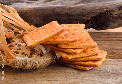 Thin sheet cookies on a wooden background
