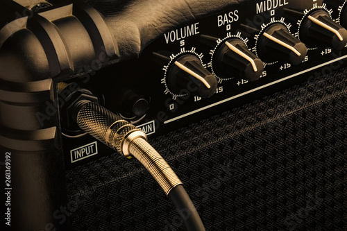Foto Guitar amplifier with jack plugged in. Close up macro view