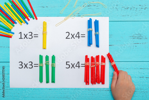kid doing multiplication equations using counting rods Wallpaper Mural