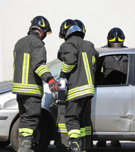 Fire Brigade Opens The Door Of The Car With A Powerful Shear Aft
