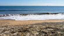 The North Sea Tide Coming In At Seaham Hall Beach In County Durham, England UK.  Image Taken On A Warm Sunny Day With The Camera Body Sat On A Stone Wall.