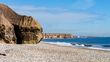 Cliff Face With A Large Cave Embedded Within At Seaham Hall Beach, County Durham, Tyne And Wear, England UK. North East Coastline In The Background With The North Sea To The Right.