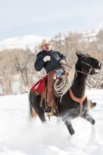 Cowboy Riding Horse On Snowy L...