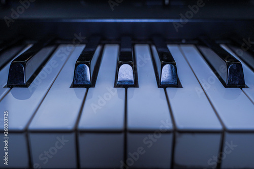 Piano keyboard background. Piano keys side view - 268383725