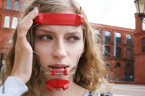 Shy Girl with Orthodontic Headgear Braces and Facemask Canvas Print