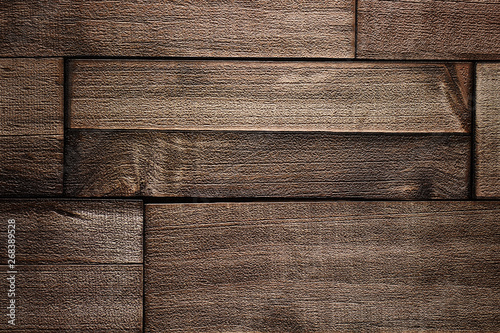 Fotografiet  Brown colored rough wooden floorboard design backdrop background