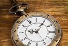 Vintage Pocket Watch Clock On Wooden Background