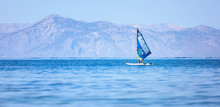 Windsurfing Over The Sea. Recreational Water Sports.