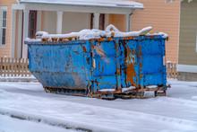Dumpster On The Snow Covered Ground Against Houses In Daybreak Utah