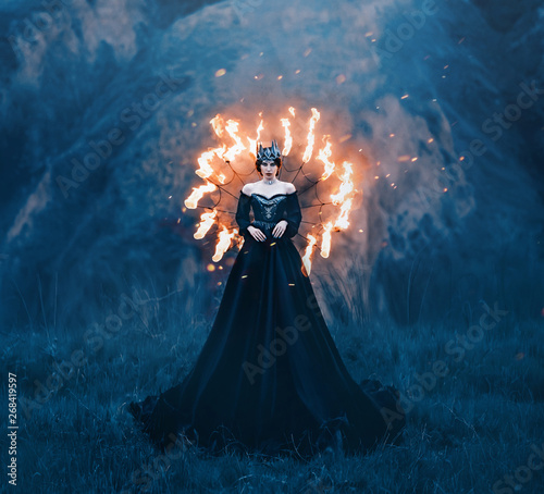 Foto  dark queen of night, majestic priestess in long black dress with bare shoulders,