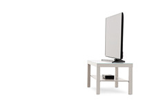 Side View Shot Of A Flat Screen TV On A White Shelf