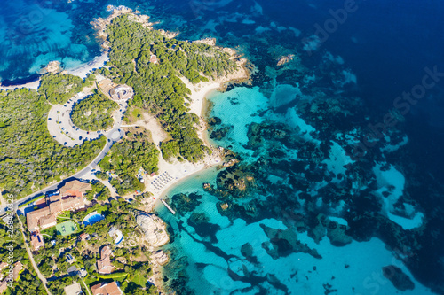 View from above, stunning aerial view of the Capriccioli Beach bathed by a beautiful turquoise sea Fototapet