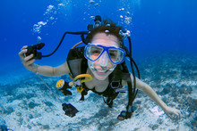 Female Scuba Diver Smiling Und...