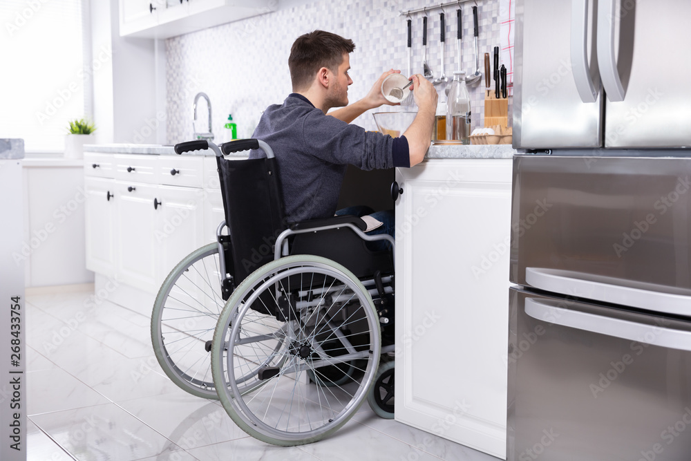 Fototapety, obrazy: Disabled Man Preparing Food In Kitchen