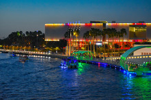 Tampa Bay, Florida. March 02, 2019 Illuminated Tampa Museum Of Art, Riverwalk And Boats Sailing On Hillsborough River In Downtown Area.