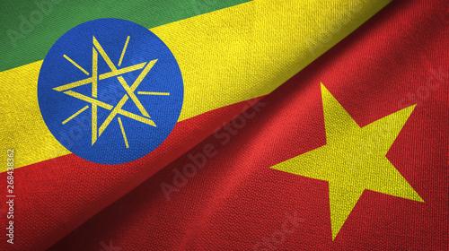 Obraz na plátne Ethiopia and Vietnam two flags textile cloth, fabric texture