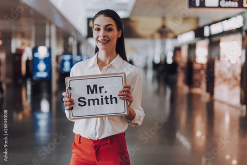 Poster Positive Typography Easy-going girl is meeting guest arriving at airport