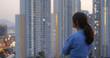 Leinwandbild Motiv Confident woman look at the city with sunset time