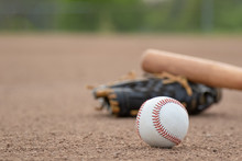 Baseball, Glove And Bat In The Infield Dirt