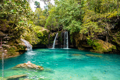 Fotomural Kawasan Falls on Cebu island in Philippines, turquoise waterfalls