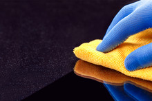 Hand In Protective Glove Wipin...