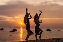 Silhouette Of Two Young Beauti...