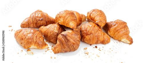 Obraz na plátně  Freshly baked croissants  isolated on white background .