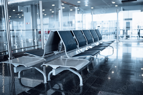 Bench in the terminal of airport Canvas Print
