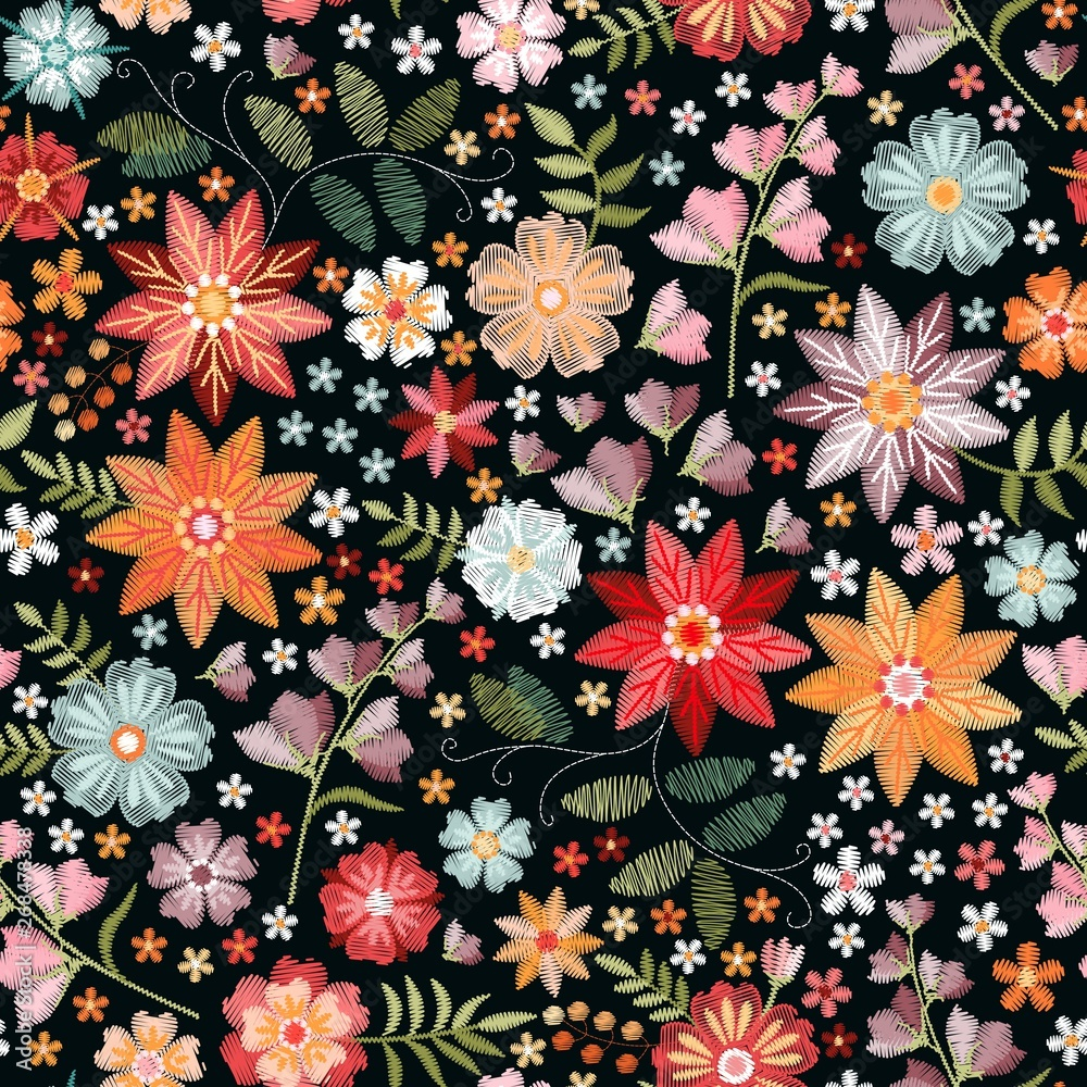 Embroidery seamless pattern with beautiful colorful flowers in boho style. Fashion print for fabric, textile, wrapping paper.